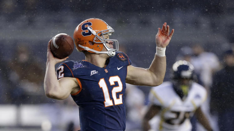 Syracuse quarterback Ryan Nassib (12) drops back for a pass against West Virginia during the Pinstripe Bowl NCAA college football game at Yankee Stadium in New York, Saturday, Dec. 29, 2012. (AP Photo/Kathy Willens)