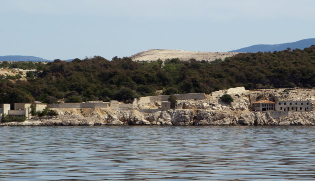 In this photo taken June 28, 2012, the Adriatic island of Goli Otok is seen from the sea. The prison island housed up to 16,000 political prisoners over an eight-year period. They ended up there after being accused by Tito&#39;s regime of expressing sympathy toward Josef Stalin and his hardline Soviet dictatorship. (AP Photo/Darko Bandic)