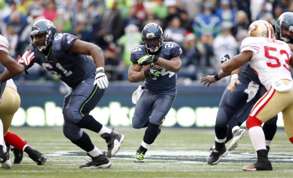 Seattle Seahawks'  Marshawn Lynch rushes against the San Francisco 49ers in the first half of an NFL football game Saturday, Dec. 24, 2011, in Seattle. (AP Photo/Kevin Casey)