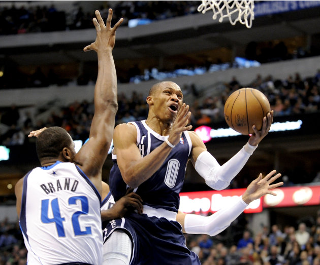 Oklahoma City Thunder guard Russell Westbrook (0) drives around Dallas Mavericks forward Elton Brand (42) during the first half of an NBA basketball game, Friday, Jan. 18, 2013, in Dallas. (AP Photo/M