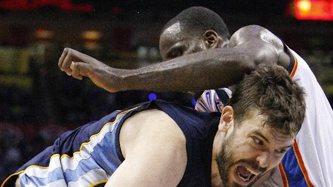 Memphis Grizzlies Marc Gasol, left, drives to the basket as Oklahoma City Thunder's Kendrick Perkins defends during the fourth quarter of Game 1 of their NBA basketball playoff series in the Western Conference semifinals, Sunday, May 5, 2013, in Oklahoma City. Oklahoma City won 93-91. (AP Photo/Alonzo Adams)