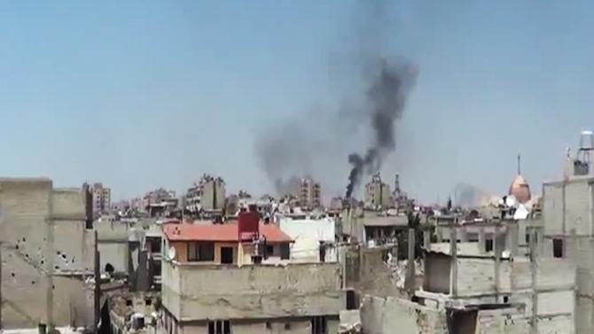 """In this image made from amateur video released by the Shaam News Network and accessed Monday, May 28, 2012, purports to show black smoke rising from buildings in Homs, Syria. U.N. envoy Kofi Annan called Monday on """"every individual with a gun"""" in Syria to lay down arms, saying he was horrified by a weekend massacre that killed more than 100 people, including women and small children. (AP Photo/Shaam News Network via AP video) TV OUT, THE ASSOCIATED PRESS CANNOT INDEPENDENTLY VERIFY THE CONTENT, DATE, LOCATION OR AUTHENTICITY OF THIS MATERIAL"""