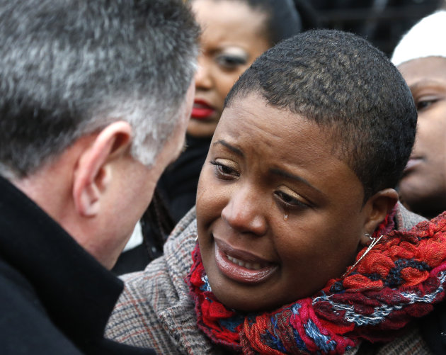 Cleopatra Pendleton cries as she talks with Chicago Police Superintendent Garry McCarthy before a news conference seeking help from the public in solving the murder of Pendleton's daughter Hadiya Wedn