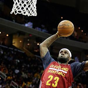 LeBron James dunks after between-the-legs pass from Kyrie Irving in Cavaliers open scrimmage