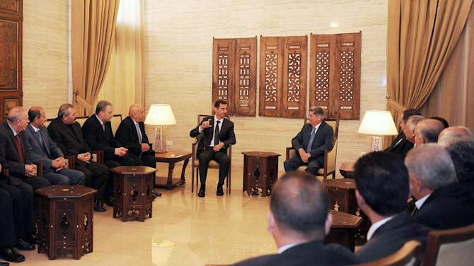 In this photo released by the Syrian official news agency SANA, Syrian President Bashar Assad, center left, meets with a delegation of Jordanian political activists, lawyers, doctors and engineers in support of him, in Damascus, Syria, Monday, Feb. 11, 2013.  Syrian rebels captured the country's largest dam on Monday after days of intense clashes, giving them control over water and electricity supplies for much of the country in a major blow to President Bashar Assad's regime. (AP Photo/SANA)