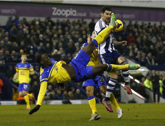 Everton's Romelu Lukaku is challenged by West Bromwich Albion's Liam Ridgewell as he attempts an overhead kick during their English Premier League soccer match at The Hawthorns in West Bromwic