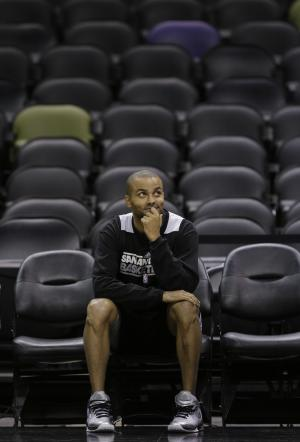 San Antonio Spurs' Tony Parker, of France, sits on the sidelines NBA basketball practice Wednesday, June 12, 2013, in San Antonio. The Spurs lead the Miami Heat 2-1 in the best-of-seven series, Game 4 of the NBA finals series is scheduled for Thursday. (AP Photo/Eric Gay)