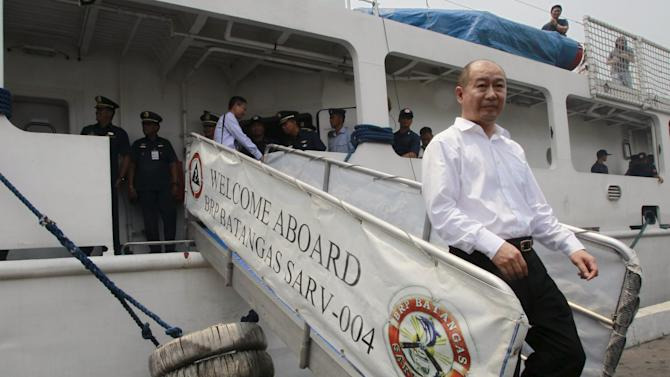 Hongguand alights PCG BRP Batangas after observing a combined maritime law enforcement exercise at a bay in Manila