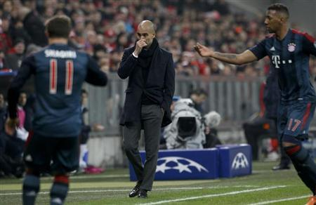 Bayern Munich coach Pep Guardiola (C) reacts after their Champions League Group D soccer match against Manchester City in Munich December 10, 2013. REUTERS/Michaela Rehle
