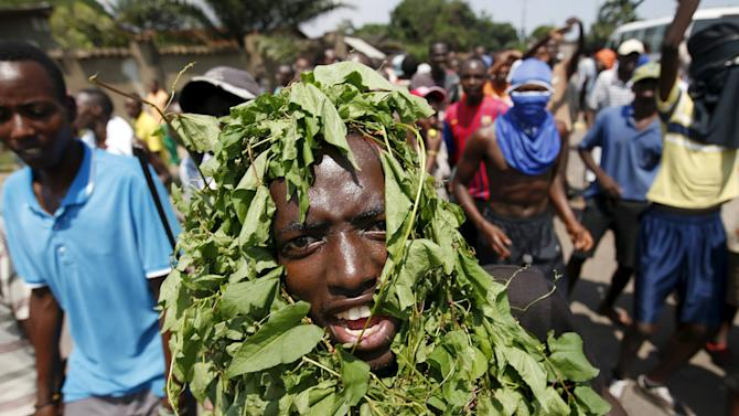 Protester uses grass to obscure his identity during a protest against President Pierre Nkurunziza's decision to run for a third term in Bujumbura