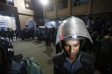 Police officers stand guard in front of the central jail in Dhaka