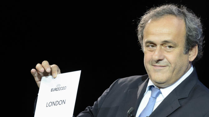 UEFA-President Michel Platini shows the name of London, host of the final, during the UEFA Euro 2020 Hosts Announcement Ceremony at the Espace Hippomene in Geneva, Switzerland, Friday, September 19, 2014. The UEFA Euro 2020  tournament will be held in thirteen cities in thirteen different European countries. (AP Photo/KEYSTONE/Laurent Gillieron)