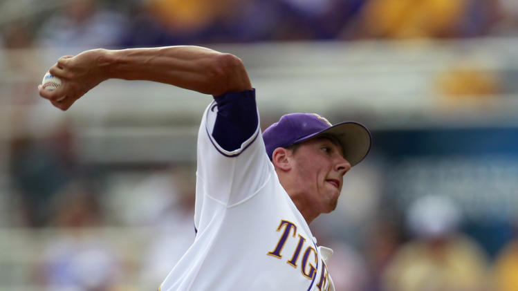 LSU pitcher Kevin Gausman (12) pitches against Stony Brook in the 12th inning of an NCAA college baseball tournament super regional game in Baton Rouge, La., Saturday, June 9, 2012.  The game was a continuation of extra innings from Friday's rain postponement, and LSU won 5-4. (AP Photo/Gerald Herbert)