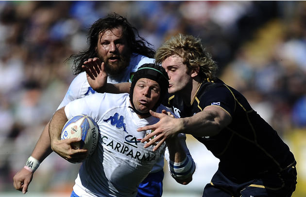 Italy's Kristopher Burton (C) is tackeld by Scotland's Richie Gray during their Rugby Union Six Nations match at the Rome's Olympic stadium on March 17, 2012. Italy defeated Scotland 13-6.  AFP PHOTO
