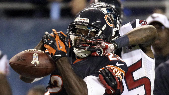 Chicago Bears wide receiver Devin Hester (23) misses a catch while under pressure from Houston Texans cornerback Kareem Jackson (25) in the first half an NFL football game, Sunday, Nov. 11, 2012, in Chicago. (AP Photo/Nam Y. Huh)