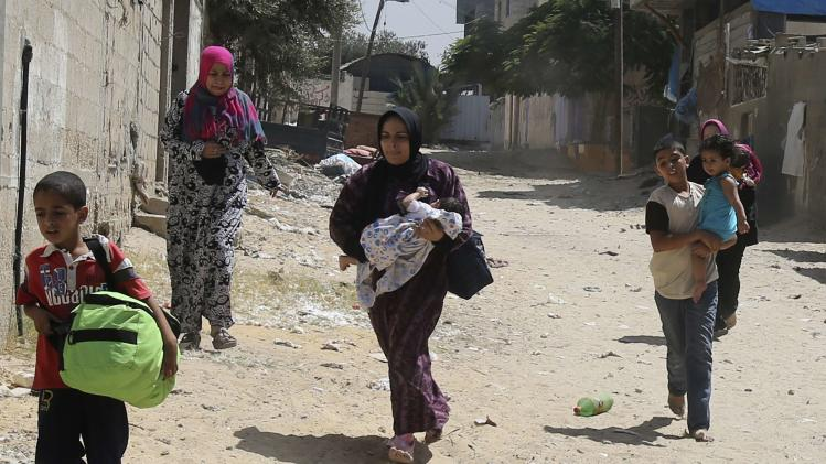 Palestinians flee from their houses in Rafah in the southern Gaza Strip