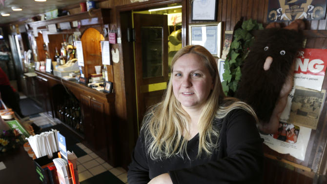 Bartender Michele Mlinar poses at Cangee's Bar and Grille on, Thursday, March 14, 2013, in Herkimer, N.Y. She said Kurt Myers, who killed four people and injured two others in a shooting rampage on Wednesday, frequently went in and had a bottle or two of Coors Light and left without speaking to anyone. She said he was always alone and she didn't even know his name until police released his mug shot on Wednesday. (AP Photo/Mike Groll)