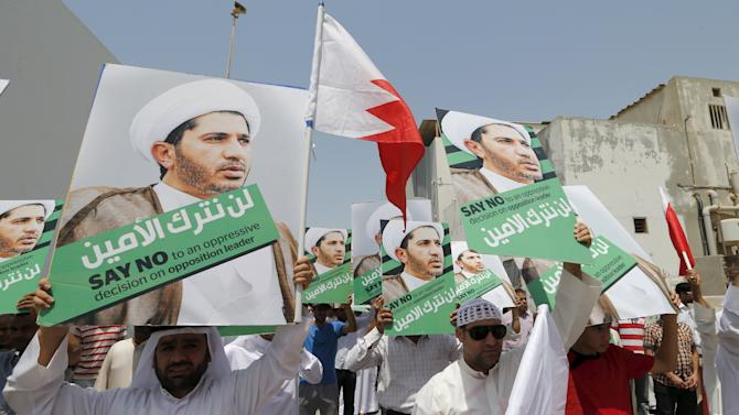 Protesters hold placards with an image of opposition leader and head of Al Wefaq party Ali Salman after Friday prayers in the village of Diraz