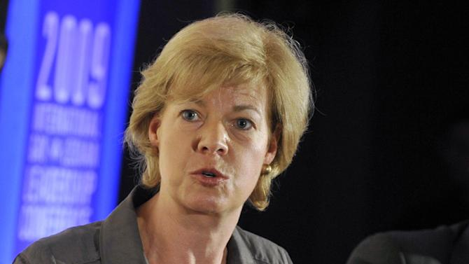 FILE - In this Dec. 5, 2009 file photo, Rep. Tammy Baldwin, D-Wis. speaks in San Francisco. Democrats have their thumbs heavily on Republican scales in Senate primaries in Missouri and Wisconsin this summer, hoping to tip the balance and improve their own chances of maintaining a majority in November.  The idea isn't as far-fetched as it might sound. (AP Photo/Russel A. Daniels, File)