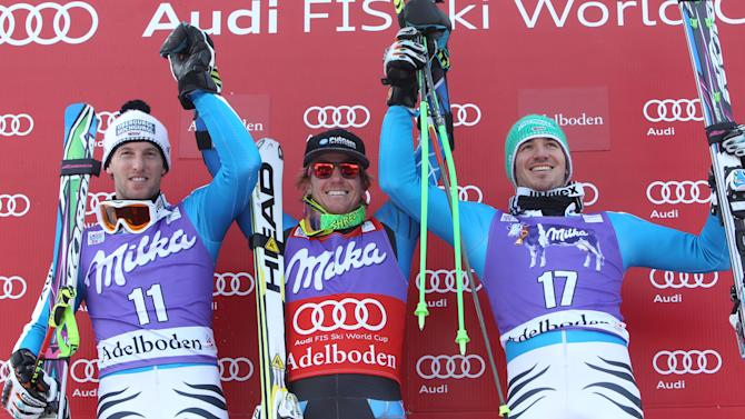 From left, Germany's Fritz Dopfer, second placed, Ted Ligety, of the Unites States, the winner and Germany's Felix Neureuther, third placed, celebrate on podium at the end of an alpine ski, men's World Cup giant slalom in Adelboden, Switzerland, Saturday, Jan.12, 2013. (AP Photo/Alessandro Trovati)
