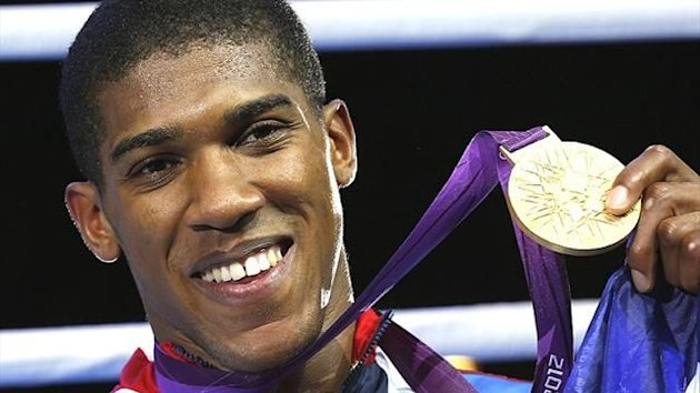 Anthony Joshua celebrates gold at the London Olympics (Reuters)