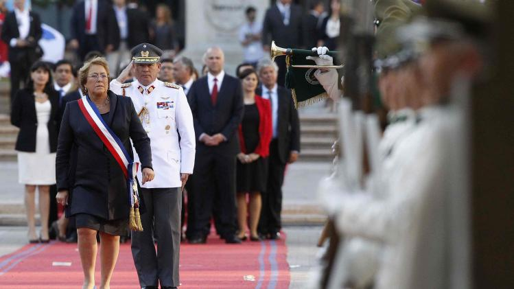 Chile's new president Michelle Bachelet receives honors at the La Moneda presidential palace after being sworn into office, in Santiago