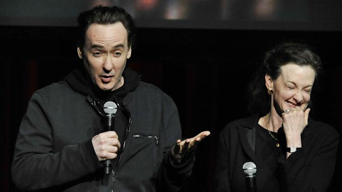 Actors John Cusack left, and Joan Cusack right, talk about Roger Ebert during a memorial for the film critic at The Chicago Theater in Chicago, Thursday, April 11, 2013. The Pulitzer Prize winning critic died last week at the age of 70 after a long battle with cancer. (AP Photo/Paul Beaty)