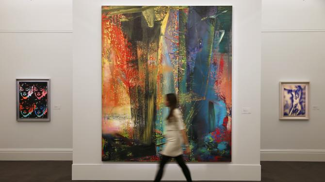 "A Sotheby's employee poses with ""Abstraktes Bild"", painted by Gerhard Richter, at Sotheby's preview in London"