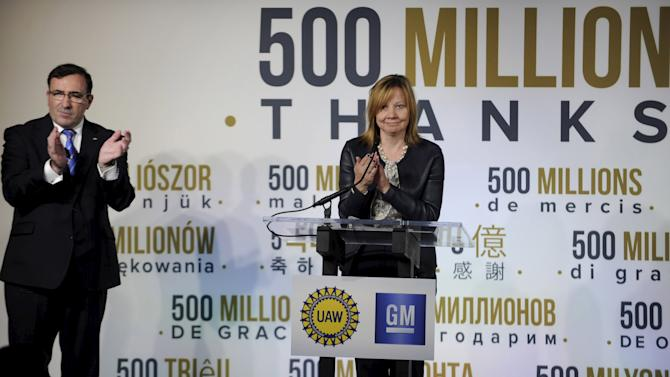General Motors CEO Barra and GM North America president Batey applaud their auto workers during ceremonies celebrating 500 Million vehicles built globally including the GM Fairfax assembly plant in Kansas City
