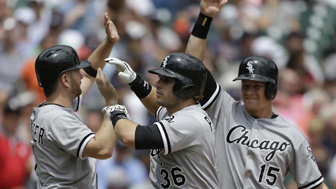 Chicago White Sox's Josh Phegley, (36) is congratulated by teammates Jeff Keppinger, left, and Gordon Beckham (15) after his grand slam during the sixth inning of a baseball game against the Detroit Tigers in Detroit, Thursday, July 11, 2013. (AP Photo/Carlos Osorio)