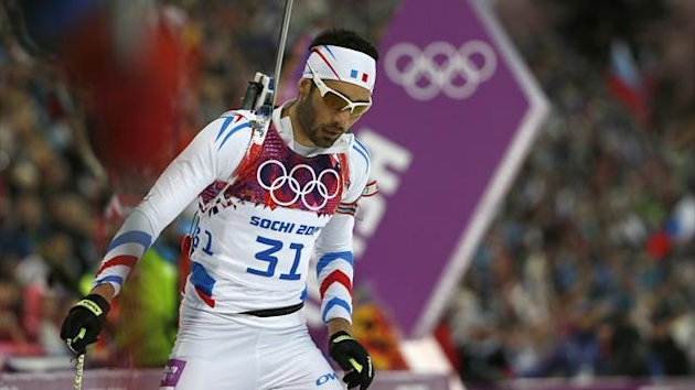 France's Martin Fourcade reacts after crossing the finish line in the men's biathlon 20km individual event at the 2014 Sochi Winter Olympics (Reuters)