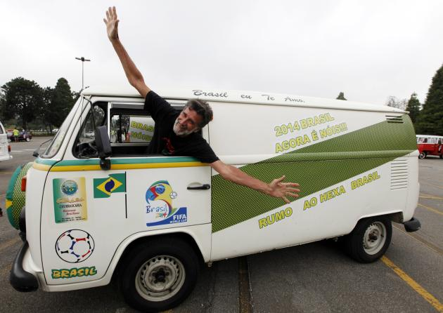 Carlos Valentim, who will travel around Brazil in his Volkswagen Kombi minibus during the 2014 World Cup, poses during a Kombi fan club meeting in Sao Bernardo do Campo