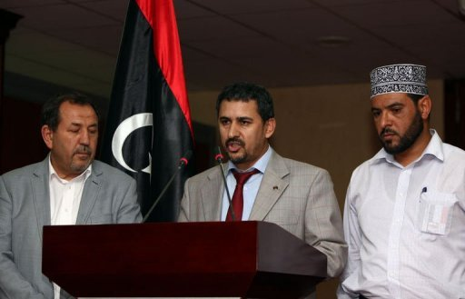 "Haramin Mohammed al-Haramin (C), deputy to Libyan Prime Minister Abdel Rahim al-Kib, speaks during a press conference, in the capital Tripoli. Libyan authorities declared warring mountain towns in the west of the country a ""military zone"" and called for an immediate ceasefire"