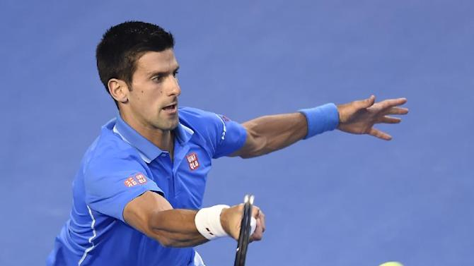 Novak Djokovic of Serbia makes a forehand return to Andy Murray of Britain during the men's singles final at the Australian Open tennis championship in Melbourne, Australia, Sunday, Feb. 1, 2015. (AP Photo/Andy Brownbill)