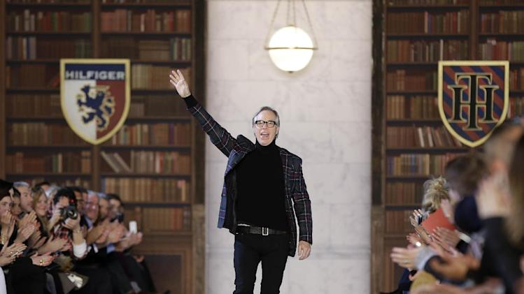 Tommy Hilfiger greets the crowd after showing his Fall 2013 collection during Fashion Week in New York, Sunday, Feb. 10, 2013.  (AP Photo/Seth Wenig)