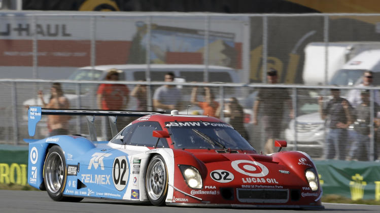 Scott Dixon, of New Zealand, drives the Ganassi Racing BMW Riley through the infield course during the Grand-Am Series Rolex 24 hour auto race at Daytona International Speedway, Sunday, Jan. 27, 2013, in Daytona Beach, Fla. (AP Photo/John Raoux)