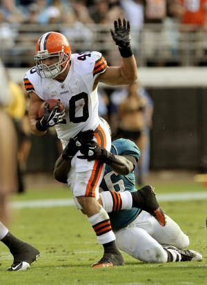 Cleveland Browns running back Peyton Hillis (40) is tackled by Jacksonville Jaguars linebacker Justin Durant (56) during the second half of an NFL football game, Sunday, Nov. 21, 2010, in Jacksonville, Fla. Jacksonville beat the Browns 24-20. (AP Photo/Stephen Morton)