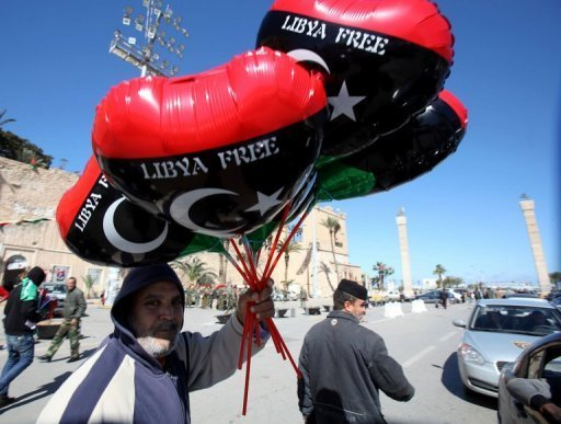 A Libyan holds balloons in the colours of the new national flag in Tripoli. Libya began celebrating on Friday the first anniversary of the uprising against Moamer Kadhafi, with fireworks and slogans, even as its new leader vowed to act firmly against further instability