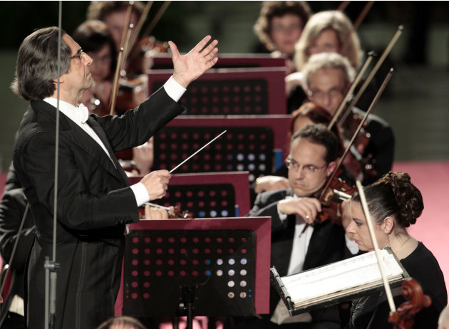 Riccardo Muti, left, conducts his orchestra during a concert offered by Italian President Giorgio Napolitano to celebrate Pope Benedict XVI's Pontificate at the Vatican, Friday, May 11, 2012. (AP Phot