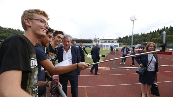 England manager Roy Hodgson poses with fans during the stadium visit