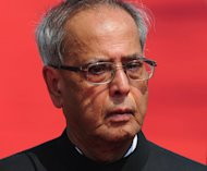 Indian President Pranab Mukherjee inspects a guard of honour after arriving at Hazrat Shahjalal International Airport in Dhaka, on March 3, 2013