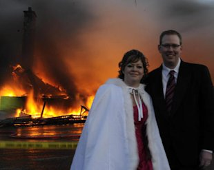 Nancy and Mike Rogers pose while their wedding plans go down in flames.