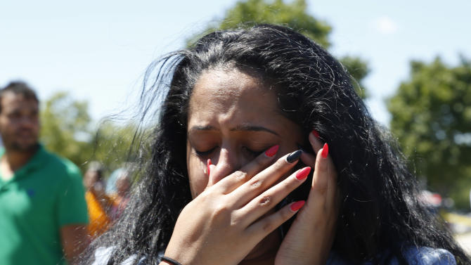 A woman reacts outside the Sikh Temple of Wisconsin in Oak Creek, Wis, after a shooting took place, Sunday, Aug 5, 2012. (AP Photo/Jeffrey Phelps)