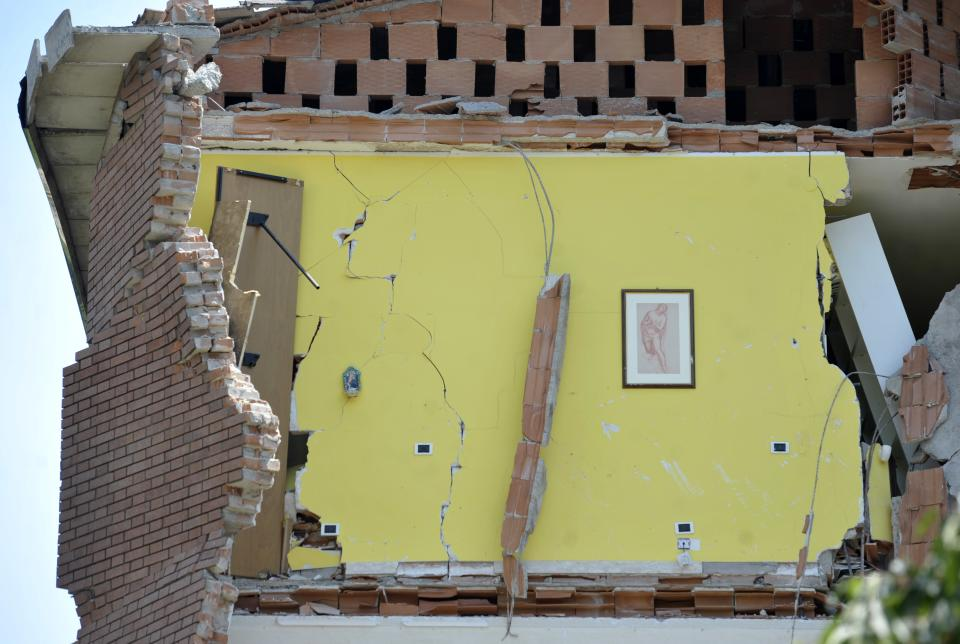 A collapsed building is seen in Cavezzo, northern Italy, Tuesday, May 29, 2012. A magnitude 5.8 earthquake struck the same area of northern Italy stricken by another fatal tremor on May 20. (AP Photo/Marco Vasini)