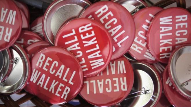 """""""Recall Walker' pins sit in a basket in the Rock County Democratic Party Headquarters on June 4. Wisconsin Gov. Scott Walker survived."""