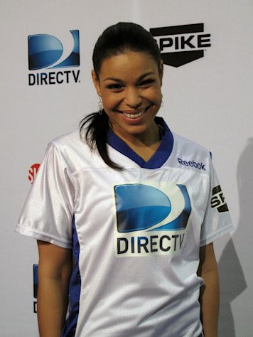 "Former ""American Idol"" champion Jordin Sparks arrives at DIRECTV's Sixth Annual Celebrity Beach Bowl on Saturday, Feb. 4, 2012 at Victory Field in Indianapolis. (AP Photo/Nekesa Moody)"
