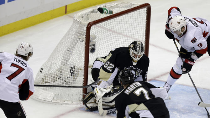 Ottawa Senators' Kyle Turris (7) scores past Pittsburgh Penguins goalie Tomas Vokoun (92) during the first period of Game 2 of an NHL hockey Stanley Cup second-round playoff series, in Pittsburgh on Friday, May 17, 2013. (AP Photo/Gene J. Puskar)