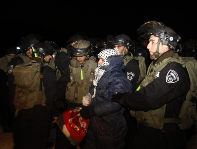 "Israeli border police evict a Palestinian activist from an area known as E-1 near Jerusalem, Sunday, Jan 13, 2013. Palestinian activists erected tents in the area on Friday saying they wanted to ""esta"