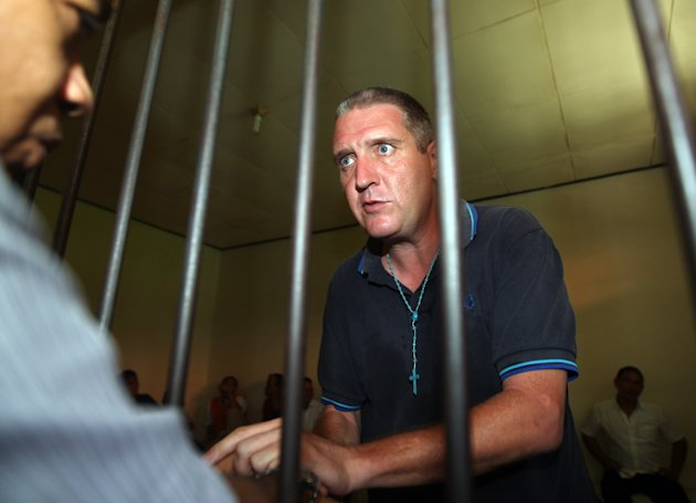 Julian Anthony Ponder of Britain waits inside a holding cell as he talks to his lawyer before the start of his verdict trial at a courthouse in Denpasar, Bali island, Indonesia, Tuesday, Jan. 29, 2013. The Indonesian court sentenced Ponder to six years in prison Tuesday for his role in a cocaine-smuggling case that led to a death sentence last week against a British grandmother. Ponder, 43, was convicted of receiving cocaine from 56-year-old Lindsay June Sandiford, who was found guilty of smuggling $2.5 million worth of the drug in her suitcase onto the resort island. Sandiford was sentenced Jan. 22 to death by firing squad. (AP Photo/Firdia Lisnawati)