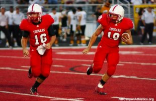 New Braunfels Canyon football plays on its red field